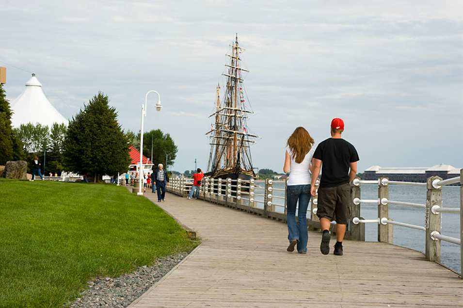 A couple walks along the Sault Ste. Marie waterfront boardwalk